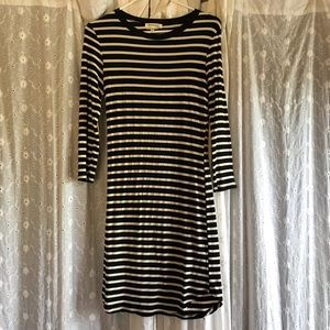Black and white striped dress with padded elbows